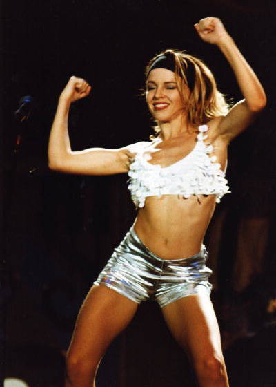 LONDON, UNITED KINGDOM - APRIL 22: Kylie Minogue performs on stage at the London Docklands Arena on April 22nd, 1990 in Londo
