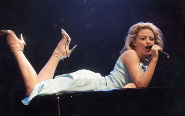 LONDON - DECEMBER 07:  Singer Kylie Minogue performs on stage on December 07, 1994 in London. (Photo by Dave Benett/Getty Ima