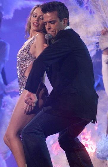 STOCKHOLM - NOVEMBER 16: British pop star Robbie Williams and Australian pop star Kylie Minogue perform on stage at the Europ