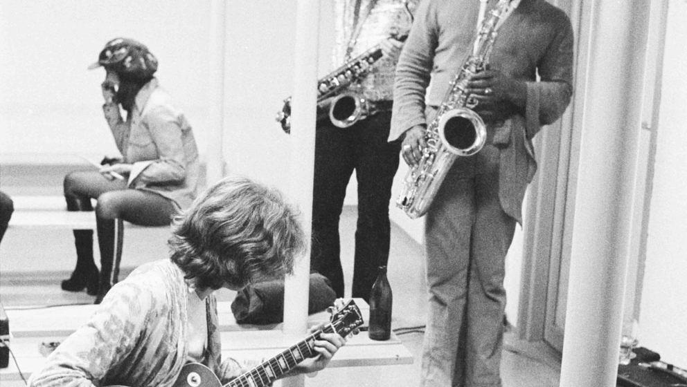 Rolling Stones guitarist Mick Taylor (left) backstage with saxophonists Bobby Keys (centre) and Trevor Lawrence at the Olympi