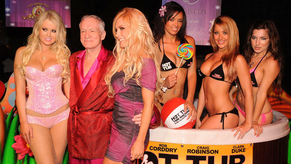 Hugh Hefner (C) and Crystal Harris (R) arrive at the 'Hot Tub Time Machine' Blu-ray and DVD launch party at the Kandyland V r