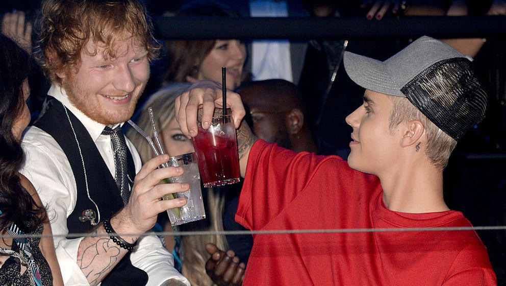 MILAN, ITALY - OCTOBER 25:  (EXCLUSIVE COVERAGE) Justin Bieber watches the show with Ed Sheeran from the Glamour pit during t