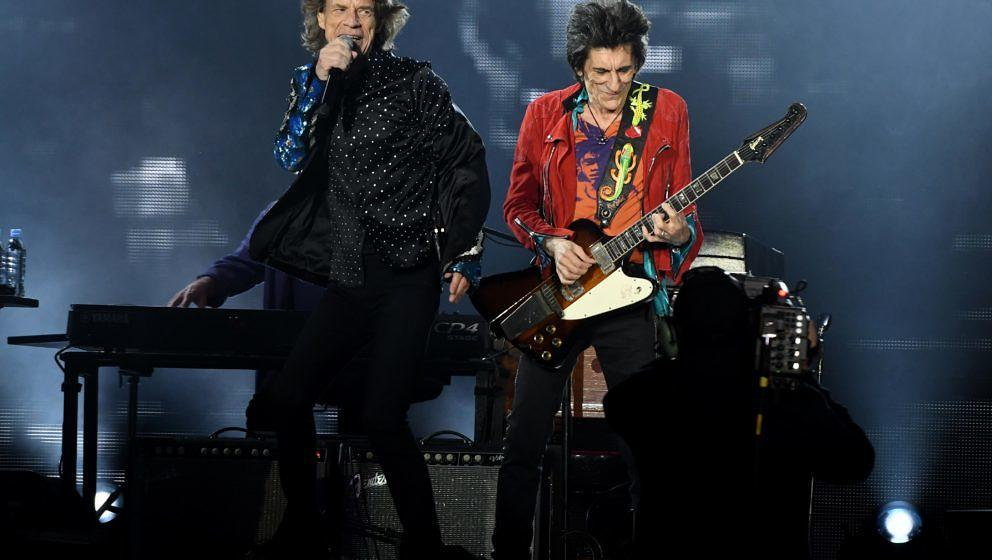 British rockband the Rolling Stones with their singer Mick Jagger and Ronnie Wood (R) perform at the Esprit arena during the