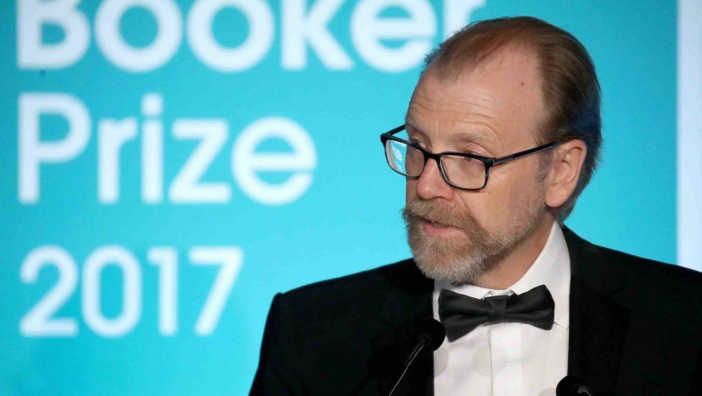 LONDON, ENGLAND - OCTOBER 17:  Winning author George Saunders on stage at the Man Booker Prize dinner and reception at The Gu