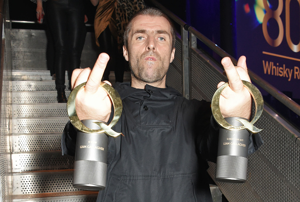LONDON, ENGLAND - OCTOBER 18:  (EDITOR'S NOTE: Image contains profanity) Liam Gallagher, winner of the Q Icon award and the Q