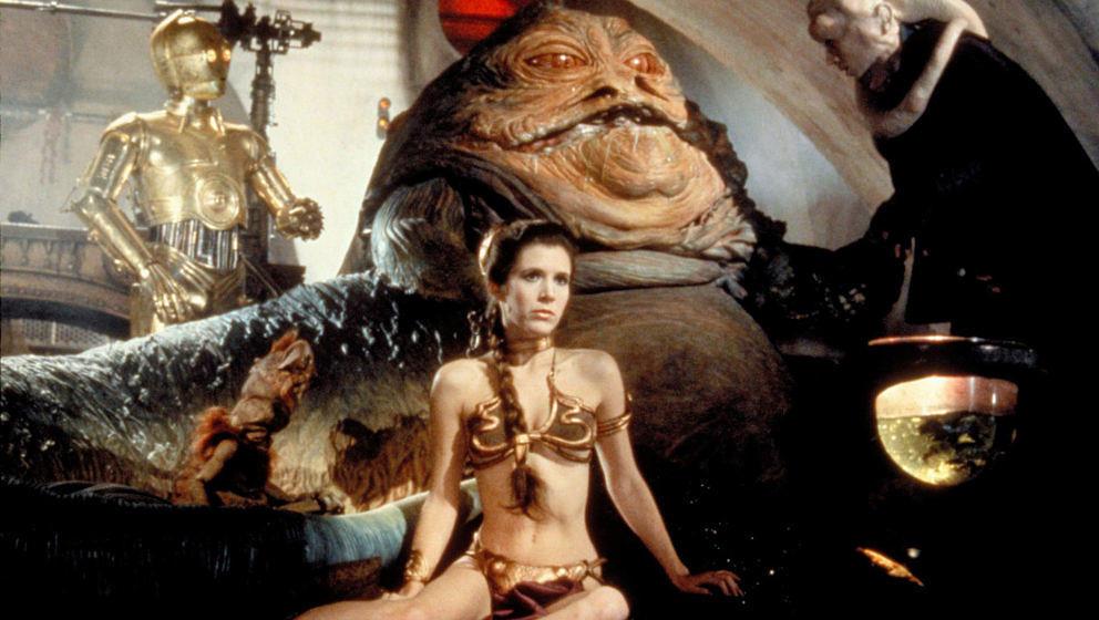 """""""Die Rückkehr der Jedi-Ritter (1983) Die Ewoks waren putzige Puppen, die Palastwachen groteske. Zielte Lucas damit auf die Zielgruppe Kinder? Und wenn schon. Dieser Zweiakter bot einen spektakulären """"Prison Break"""" aus Jabbas Festung und am Ende den herzzerreißenden Opfertod Darth Vaders, der den Sohn ein einziges Mal mit seinen eigenen Augen, ohne Helm, sehen durfte. ★★★★1/2"""