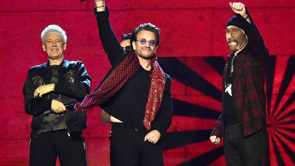 LONDON, ENGLAND - NOVEMBER 12:  U2, Bono, The Edge, Adam Clayton and Larry Mullen Jr  accept the global icon award on stage d