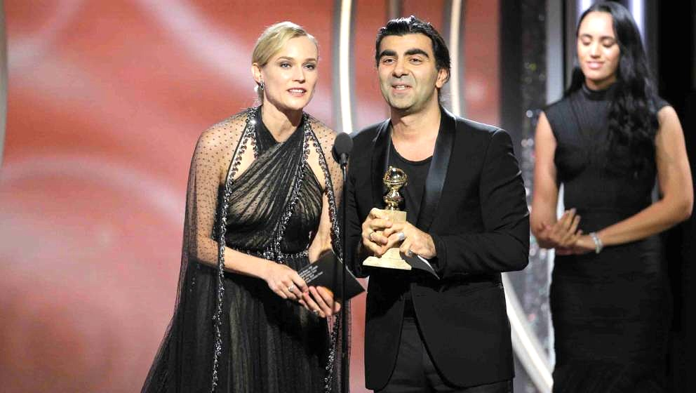 BEVERLY HILLS, CA - JANUARY 07:  In this handout photo provided by NBCUniversal,  Director Fatih Akin, with actress Diane Kru