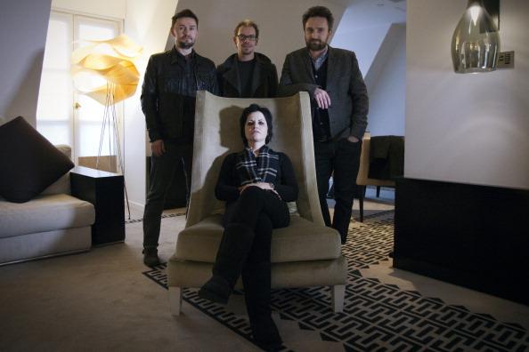The members of the Irish rock band Cranberries, singer Dolores O'Riordan (sit), bassist Mike Hogan (L), drummer Fergal Lawler