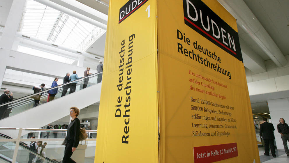 FRANKFURT/MAIN, GERMANY:  Fair-goers walk past an oversized Duden dictionary of 'Correct German Spelling' at the internationa