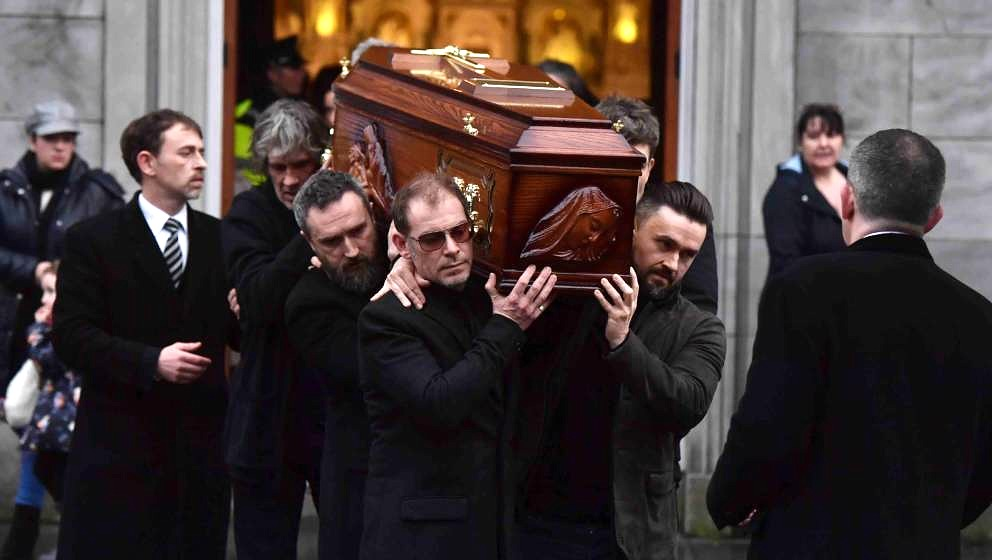 LIMERICK, IRELAND - JANUARY 21: Friends of Dolores O'Riordan carry her body from St. Joseph's church on January 21, 2018 in L