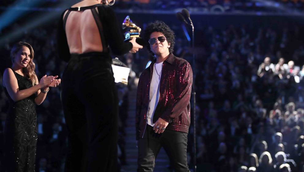 NEW YORK, NY - JANUARY 28:  Recording artist Bruno Mars (R) walks onstage to accept Album of the Year for '24K Magic' from Al