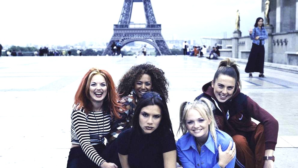 English pop girl group The Spice Girls pose in front of the Eiffel Tower in Paris, September 1996. Clockwise, from left: Geri