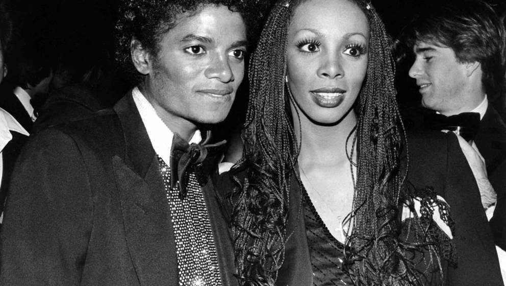1982: Pop singers Donna Summer and Michael Jackson attend an event in 1982. (Photo by Michael Ochs Archives/Getty Images)
