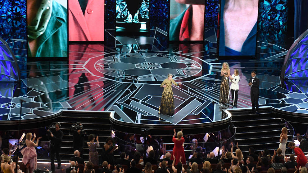 US actress Frances McDormand (C) delivers a speech next to US actresses Jodie Foster (2ndR) and Jennifer Lawrence (3rdR) afte