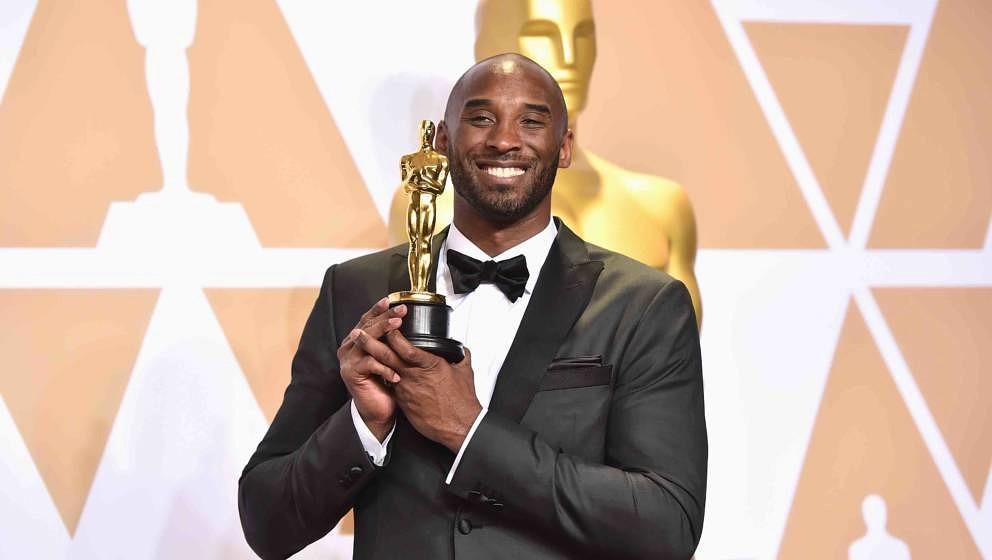 HOLLYWOOD, CA - MARCH 04:  Filmmaker Kobe Bryant, winner of the Best Animated Short Film award for 'Dear Basketball,' poses i