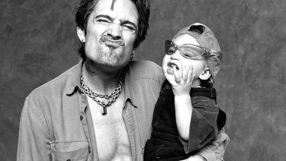 UNITED STATES - MAY 20:  HOLLYWOOD  Photo of MOTLEY CRUE and Tommy LEE, Posed studio portrait of drummer Tommy Lee with son B