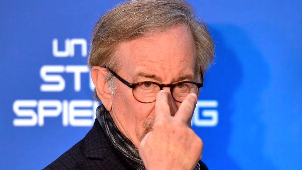 US director Steven Spielberg gestures as he poses during a photocall ahead of the premiere of his last movie 'Ready Player On