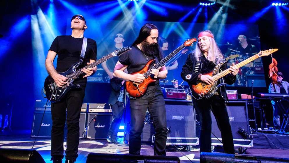 BERLIN, GERMANY - MARCH 29: (L-R) Guitarists Joe Satriani, John Petrucci and Uli Jon Roth perform live on stage during a conc