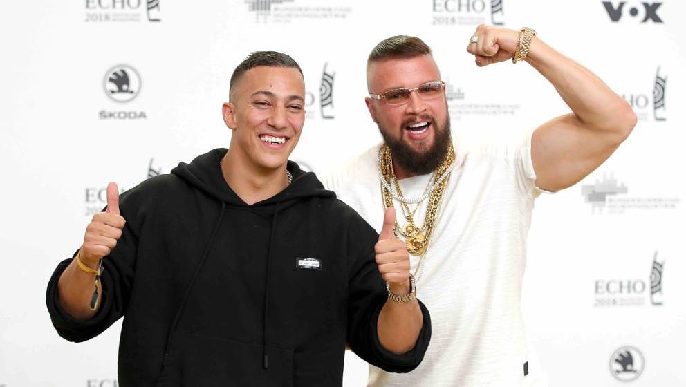 BERLIN, GERMANY - APRIL 12:  Farid Bang and Kollegah fool around as they arrive for the Echo Award at Messe Berlin on April 1