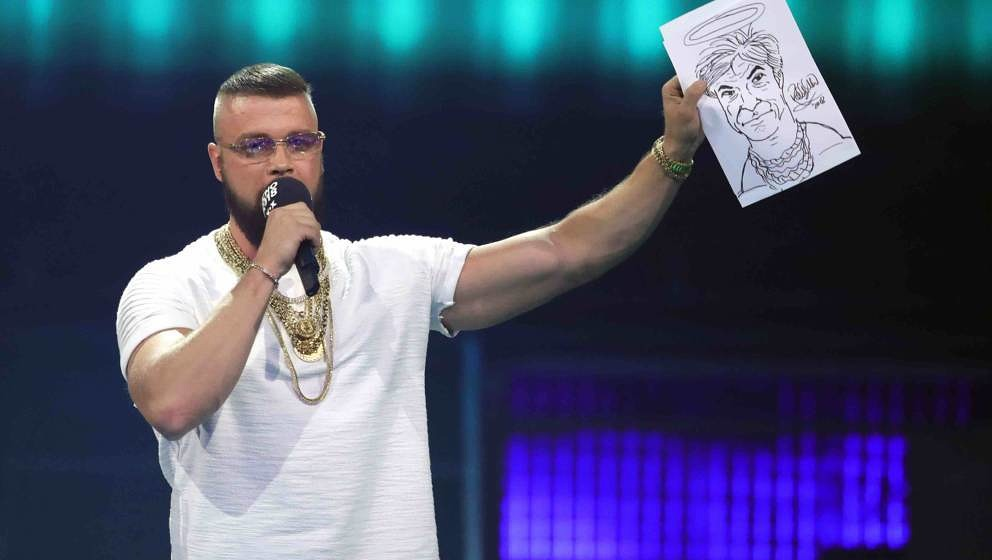 BERLIN, GERMANY - APRIL 12:  Kollegah is seen on stage teasing Campino of Die Toten Hosen during the Echo Award show at Messe