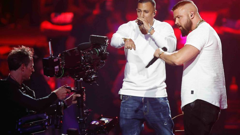 German rappers Kollegah & Farid Bang perform during the 2018 Echo Music Awards ceremony on April 12, 2018 in Berlin. / AF