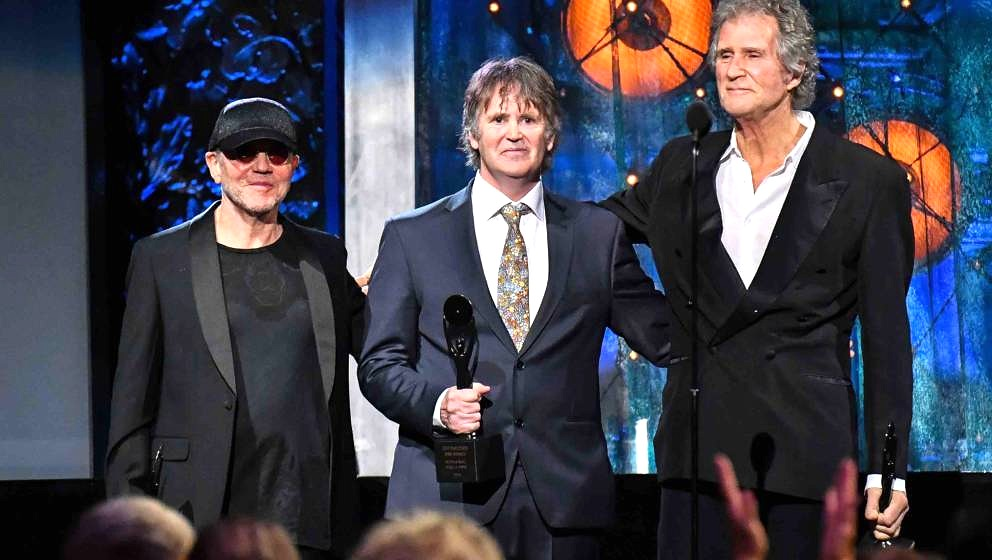 CLEVELAND, OH - APRIL 14:  (L-R) Inductees Alan Clark, Guy Fletcher and John Illsley of Dire Straits attend the 33rd Annual R
