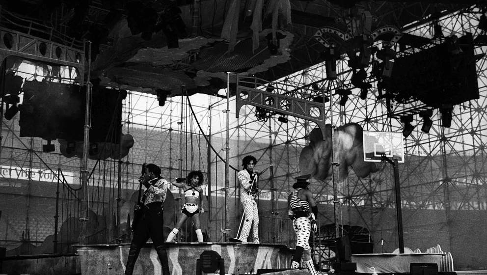 Prince and band perform on stage on the Lovesexy Tour at Feijenoord Stadion, De Kuip, Rotterdam, Netherlands, 17th August 198