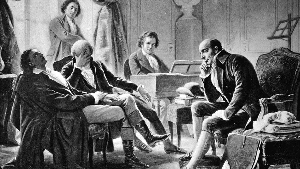 Illustration depicting German composer Ludwig Van Beethoven (1770 - 1827) performing at the pianoforte for a group of friends