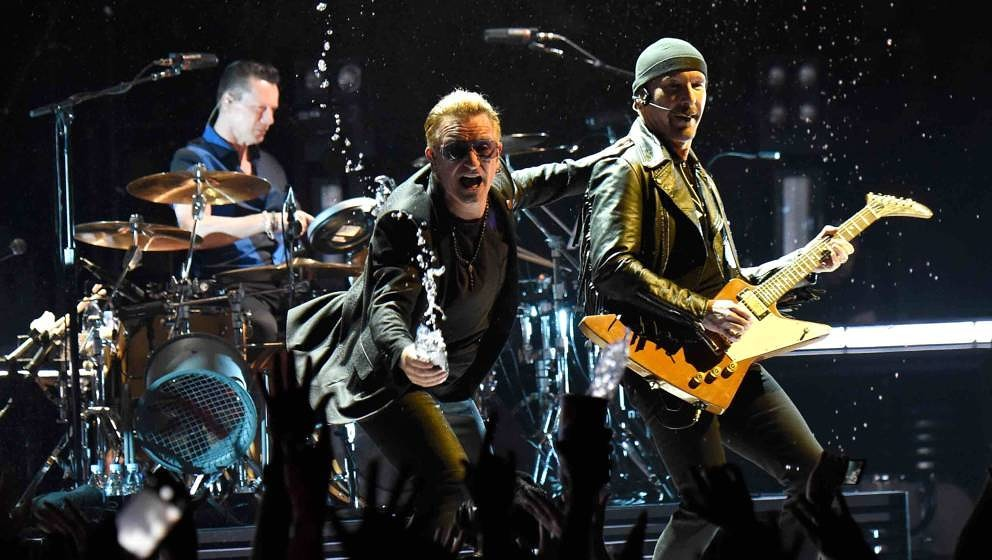 VANCOUVER, BC - MAY 14:  (L-R) Musicians Larry Mullen Jr., Bono and The Edge of U2 perform onstage during the U2 iNNOCENCE +