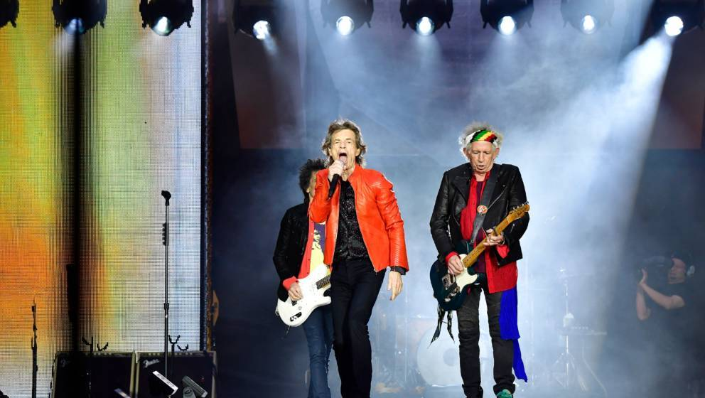 (L-R) Rolling Stones' Ron Wood, Mick Jagger and Keith Richards perform during a concert at Berlin's Olympic Stadium on June 2