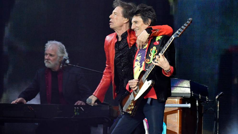 Rolling Stones' Mick Jagger (C) and Ron Wood perform with the band during a concert at Berlin's Olympic Stadium on June 22, 2