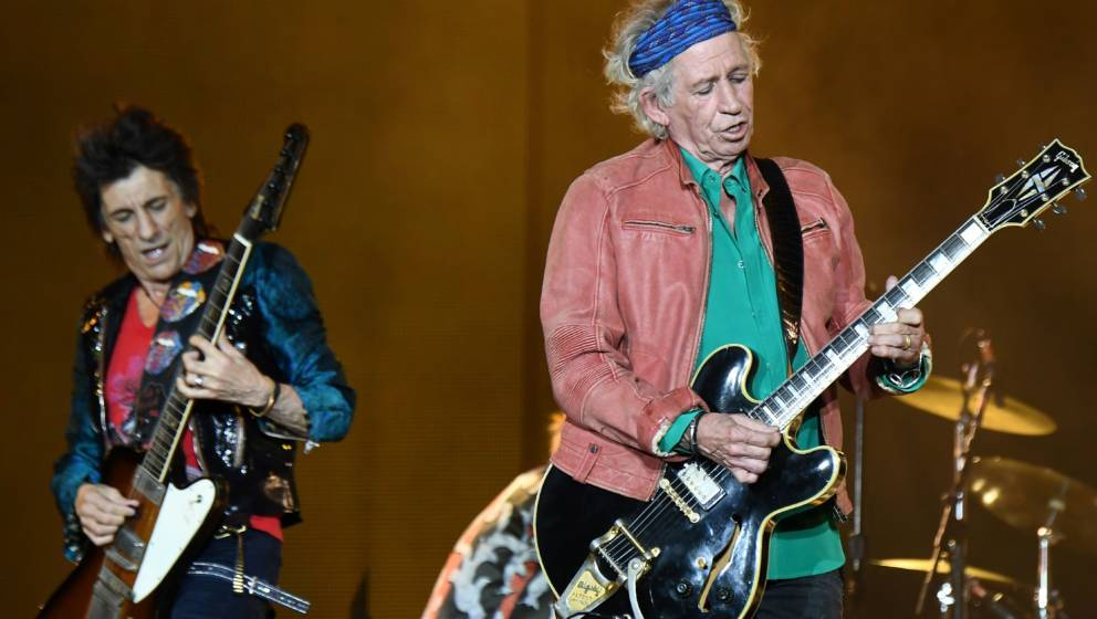 (L/R): British musicians Ronnie Wood and Keith Richards of The Rolling Stones perform during a concert at The Velodrome Stadi