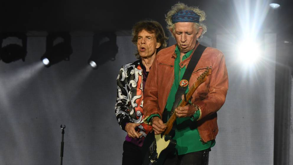 British musicians, Mick Jagger (L) and Keith Richards, of The Rolling Stones perform during a concert at The Velodrome Stadiu