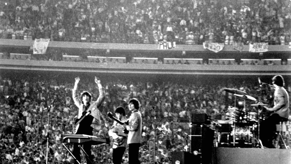 The Beatles perform at Shea Stadium, New York on 15th August 1965. (Photo by Michael Ochs Archives/Getty Images)