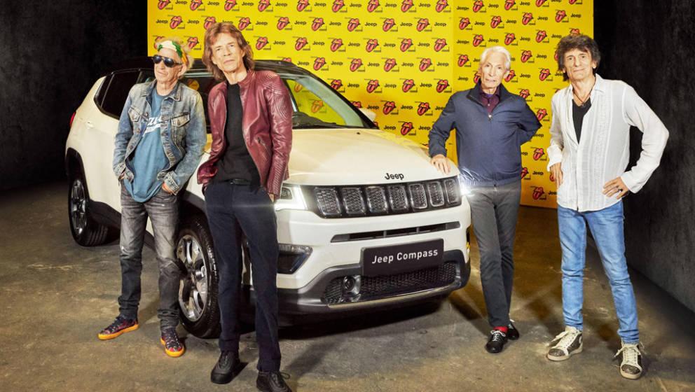 Die Rolling Stones vor dem Jeep Compass, mit dem der Gewinner zum Konzert fahren kann
