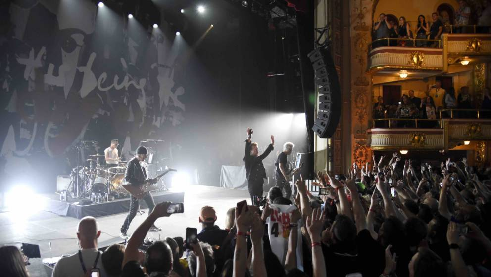 NEW YORK, NY - JUNE 11:  U2 performs onstage during SiriusXMÕs private concert with U2 at The Apollo Theater as the band tak
