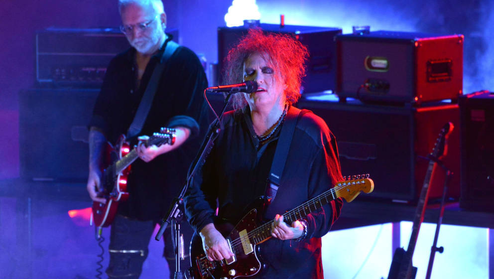 LONDON, ENGLAND - JUNE 24:  Reeves Gabrels and Robert Smith of The Cure perform live on stage during CURÆTION-25 as part of