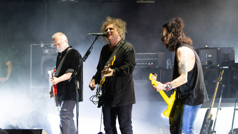 LONDON, ENGLAND - JUNE 24:  Reeves Gabrels, Robert Smith and Simon Gallup of The Cure perform at Robert Smith's Meltdown at T