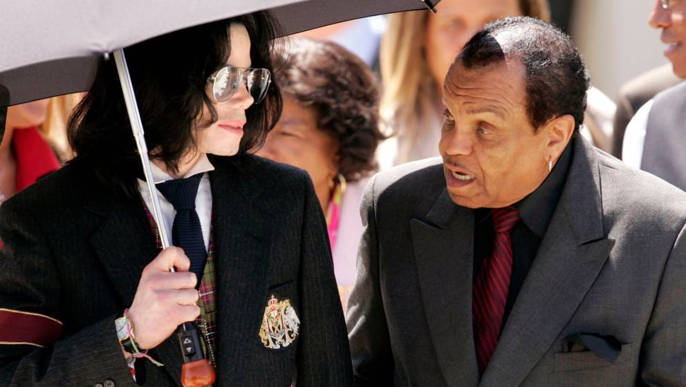SANTA MARIA, CA - JUNE 2:   Singer Michael Jackson and his father, Joseph Jackson depart courthouse after listening to closin