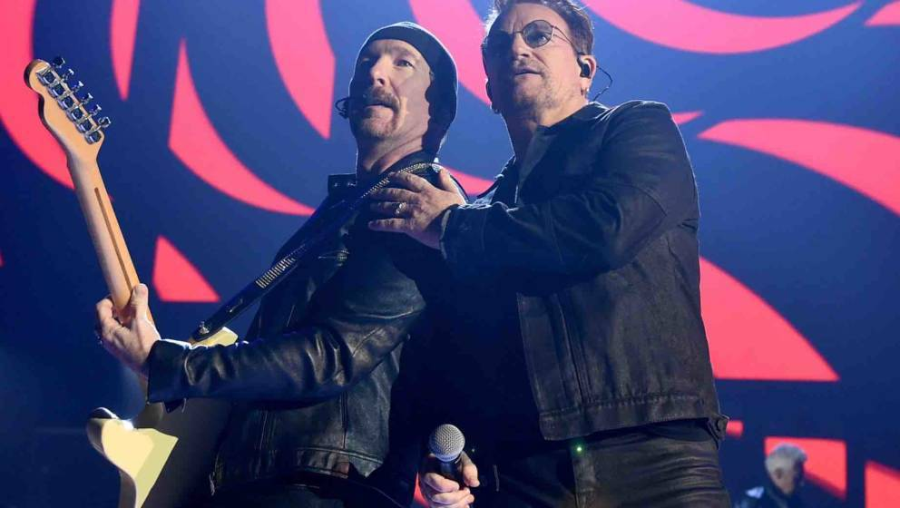 LAS VEGAS, NV - SEPTEMBER 23:  Recording artists The Edge (L) and Bono of music group U2 perform onstage at the 2016 iHeartRa