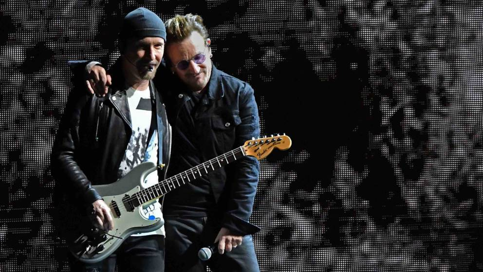 EAST RUTHERFORD, NJ - JUNE 28:  Guitar player The Edge, and Singer Bono of the band U2 perform during U2 'Joshua Tree Tour 20