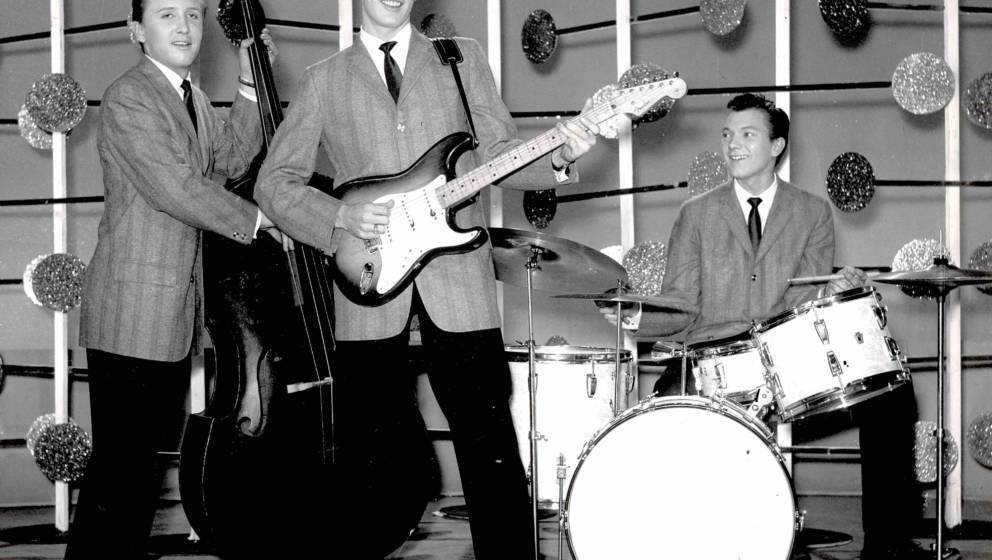 LONDON - MARCH 25: Buddy Holly And The The Crickets, (L-R) Joe B Mauldin, Buddy Holly (with Fender Stratocaster guitar) and J