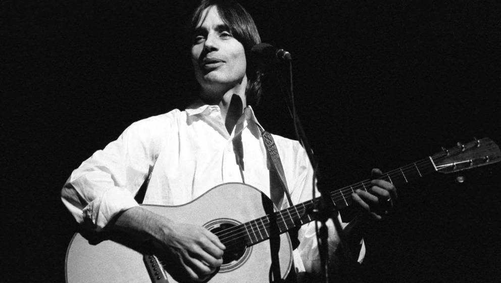 Jackson Browne performing on stage at Apollo Theatre, Manchester UK 12 April 1976. (Photo by Ian Dickson/Redferns)
