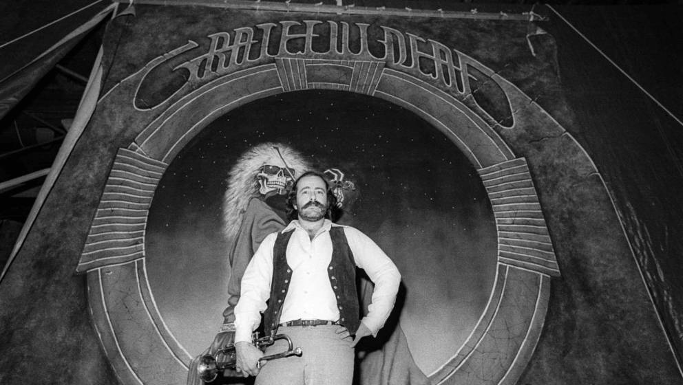 SAN RAFAEL, CA - NOVEMBER 1977:  Robert Hunter poses in front of a Blues For Allah backdrop at the Grateful Dead's rehearsal