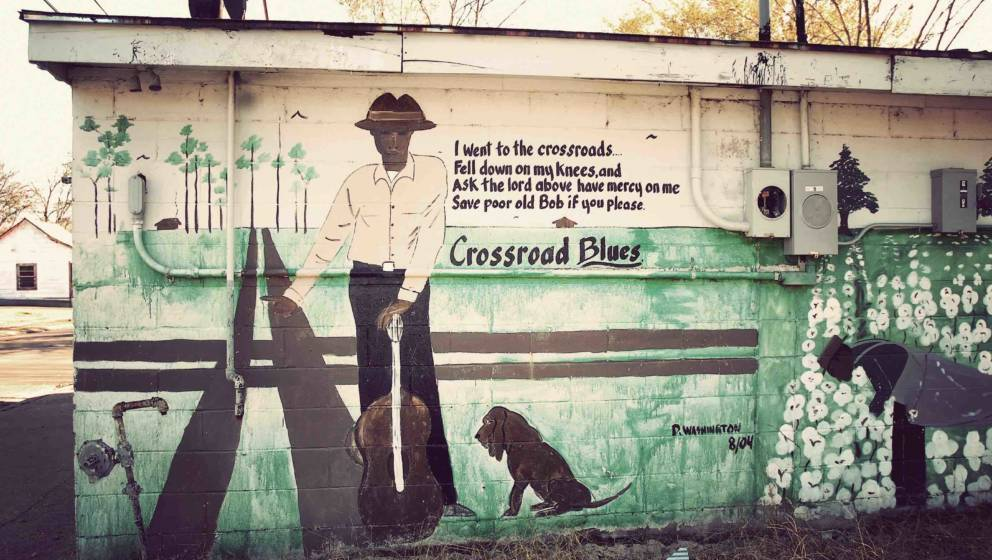 BAPTIST TOWN, UNITED STATES - SEPTEMBER 30: A mural with of legendary blues musician Robert Johnson, with lyrics from his son