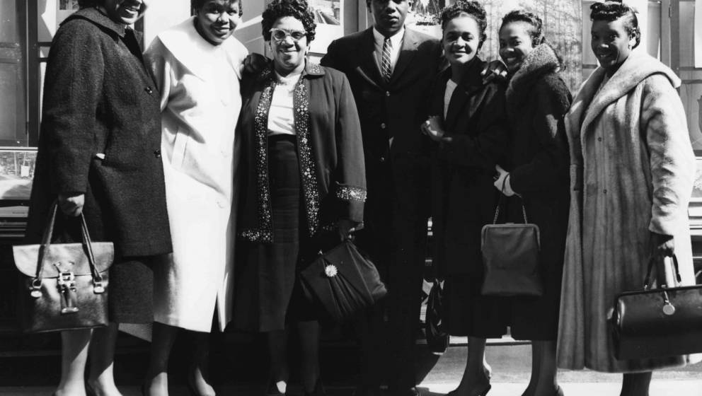 Accompanist Robert Johnson (centre) surrounded by gospel singers 'The Ward Sisters': (L-R) Edna James, Jessie Tucker, Gertrud