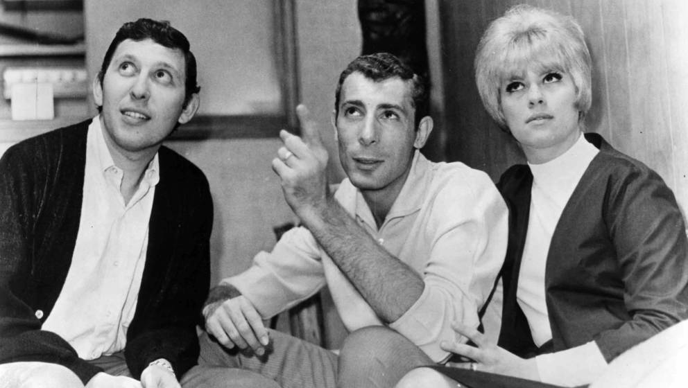 NEW YORK - CIRCA 1965:  Music producer Brooks Arthur (left) chats with songwriters and producers Jeff Barry and Ellie Greenwi