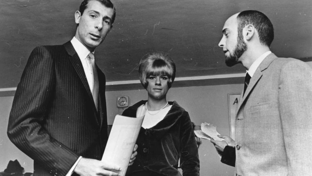 NEW YORK - CIRCA 1965: Songwriters and producers Mike Stoller (right) with Jeff Barry and Ellie Greenwich pose for a photo ci