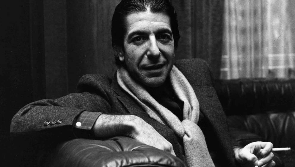 8th January 1980:  Solemn Canadian folk pop singer-songwriter Leonard Cohen shares a joke and smokes a cigarette.  (Photo by